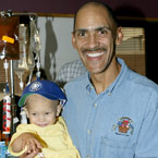 IMAGE: Tony Dungy and child