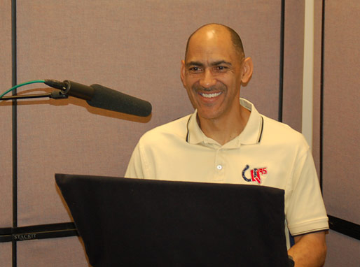 Coach enjoying the audio taping of his new book Quiet Strength