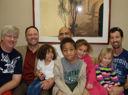 Tony Dungy (with his children), Nathan Whitaker (with his daughter) visiting WTBN in Tampa!