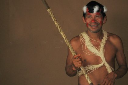 huaorani leader holding hunting spear