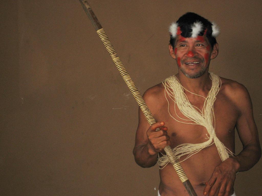 huaorani leader holding hunting spear