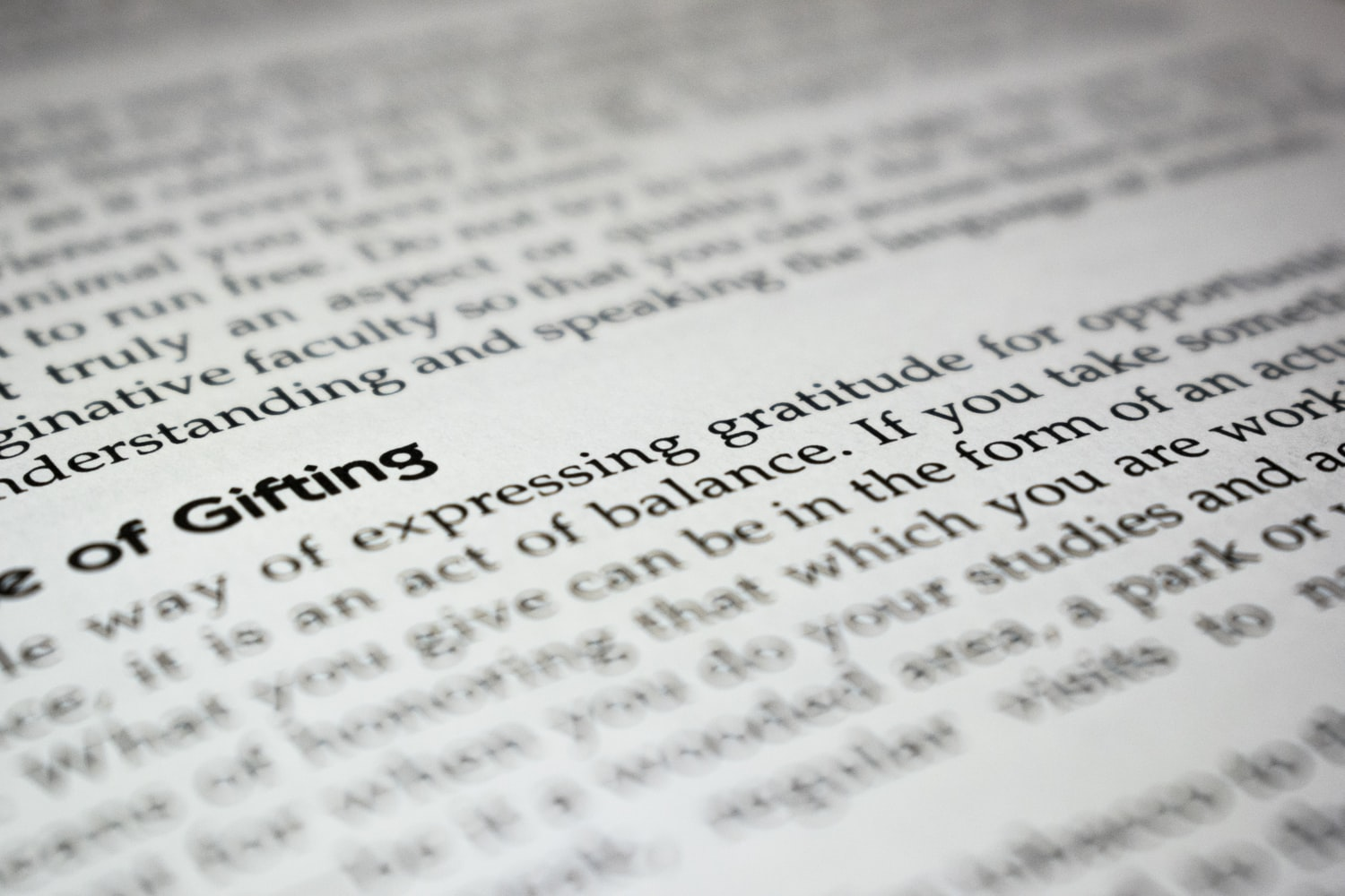the words expressing gratitude in selective focus on book page