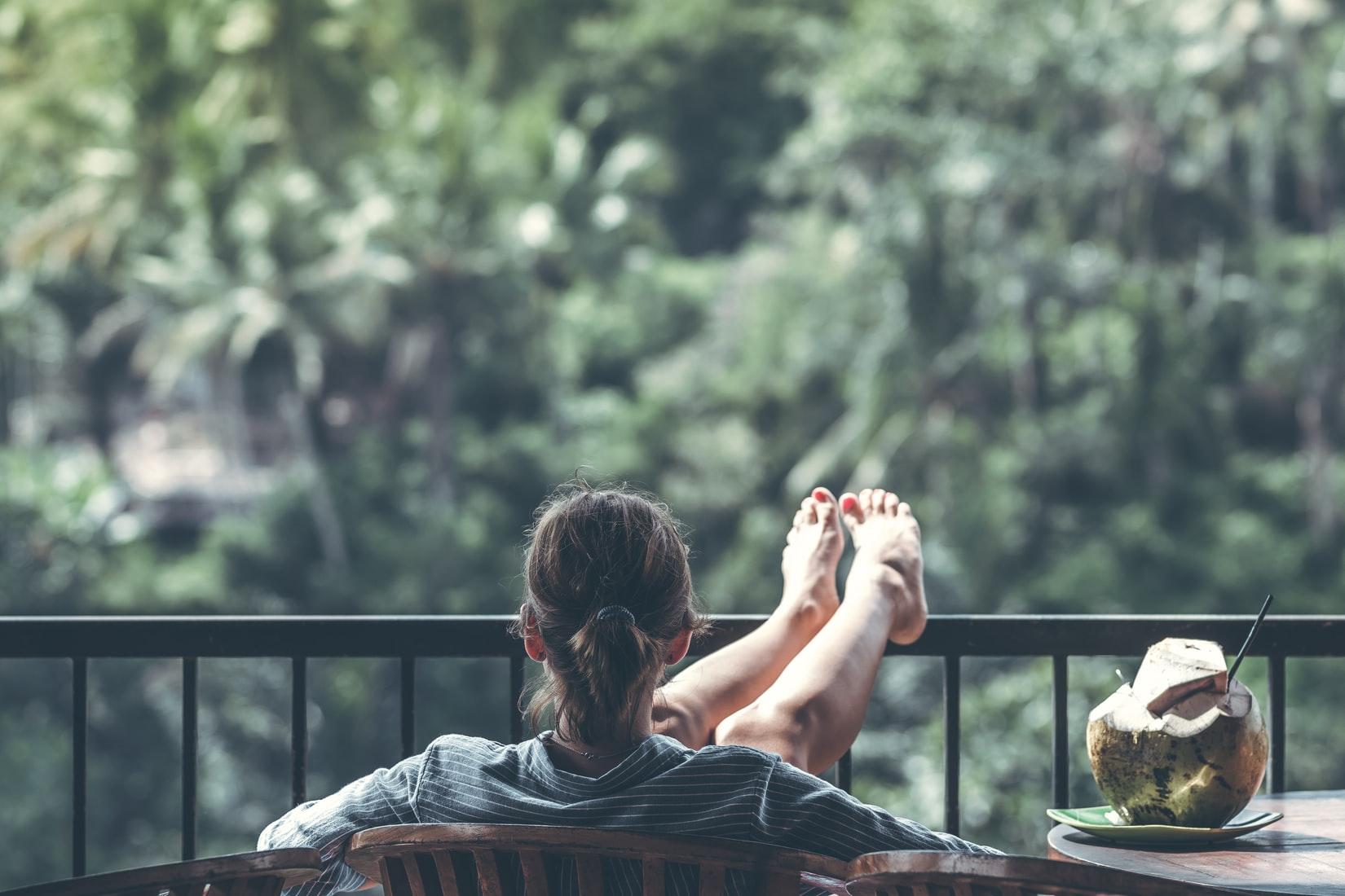 woman relaxing in chair near jungle