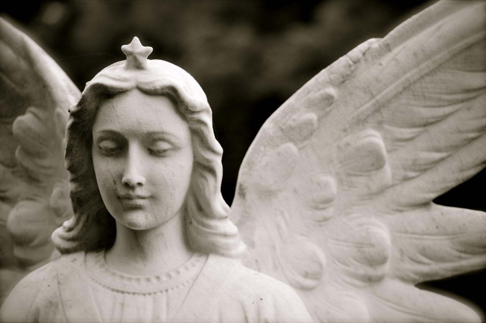 angel statue against dark background