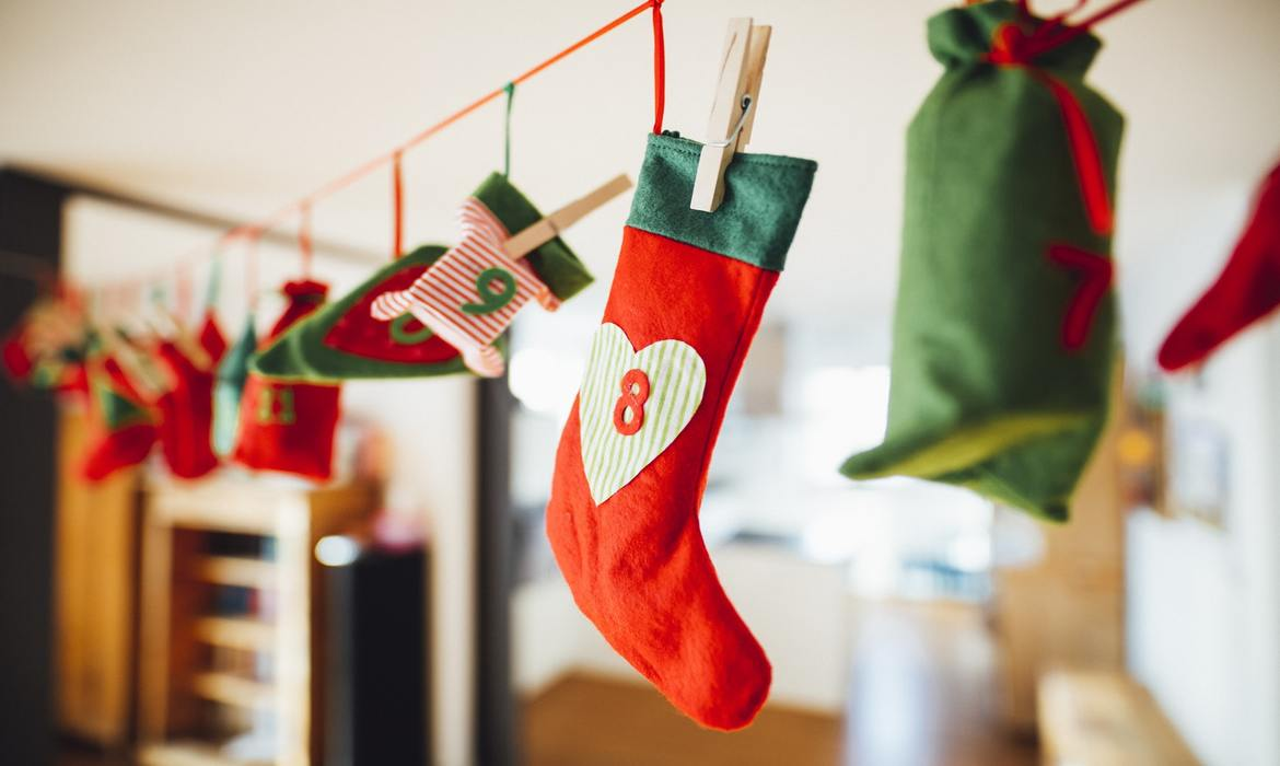 christmas stockings hanging on clothesline with clothes pins