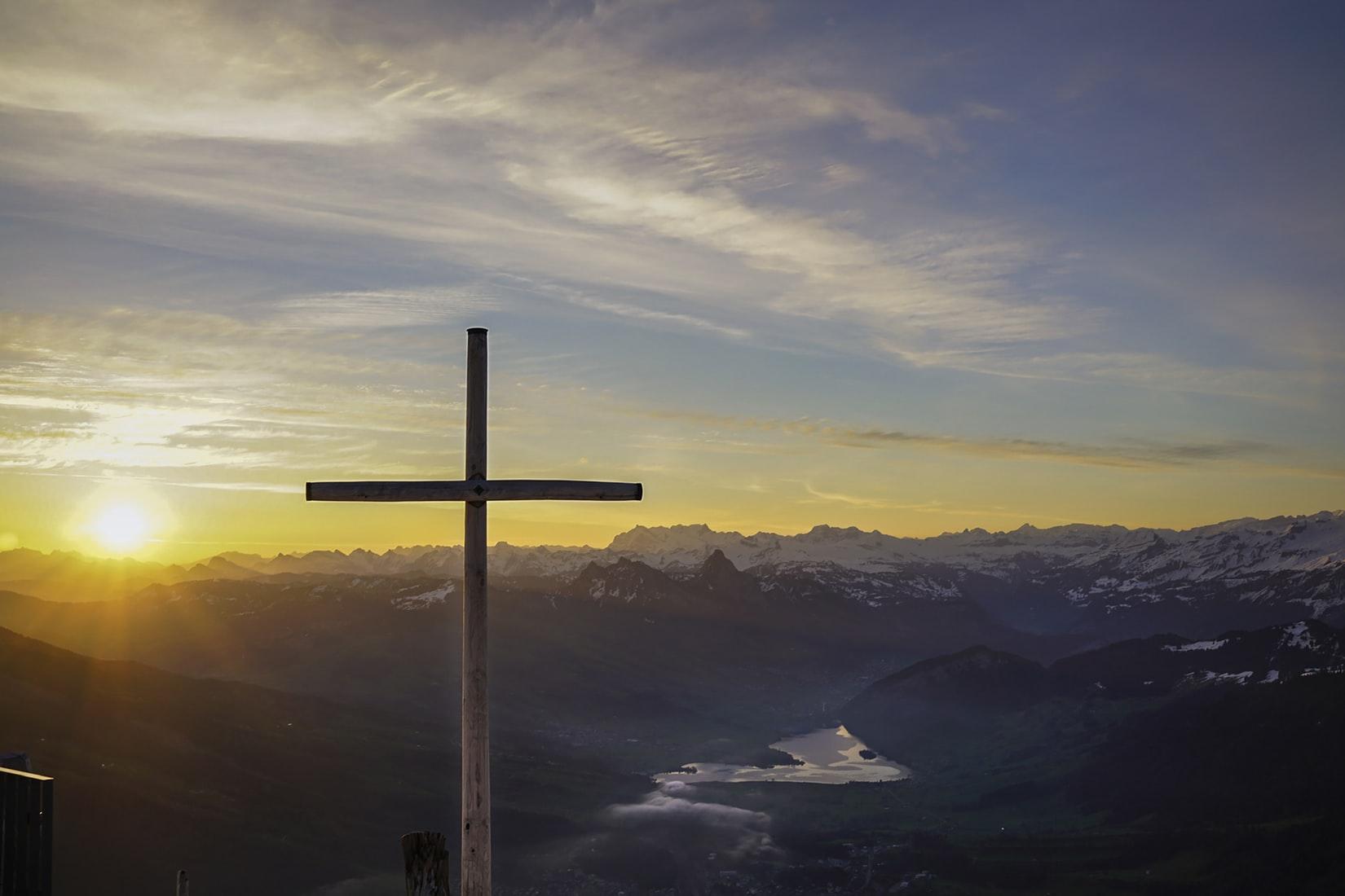 cross on mountain at sunrise