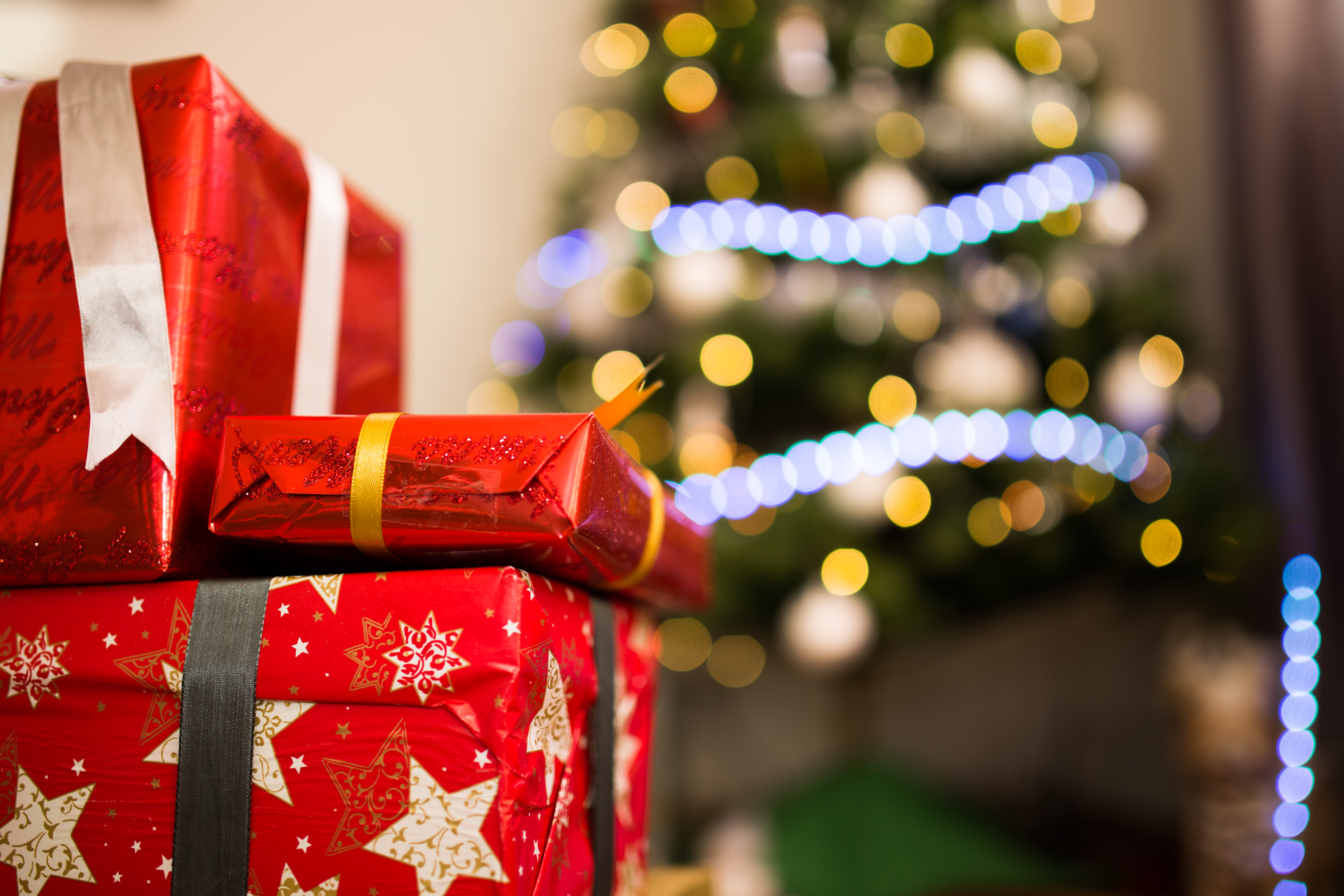 christmas gifts in front of christmas tree