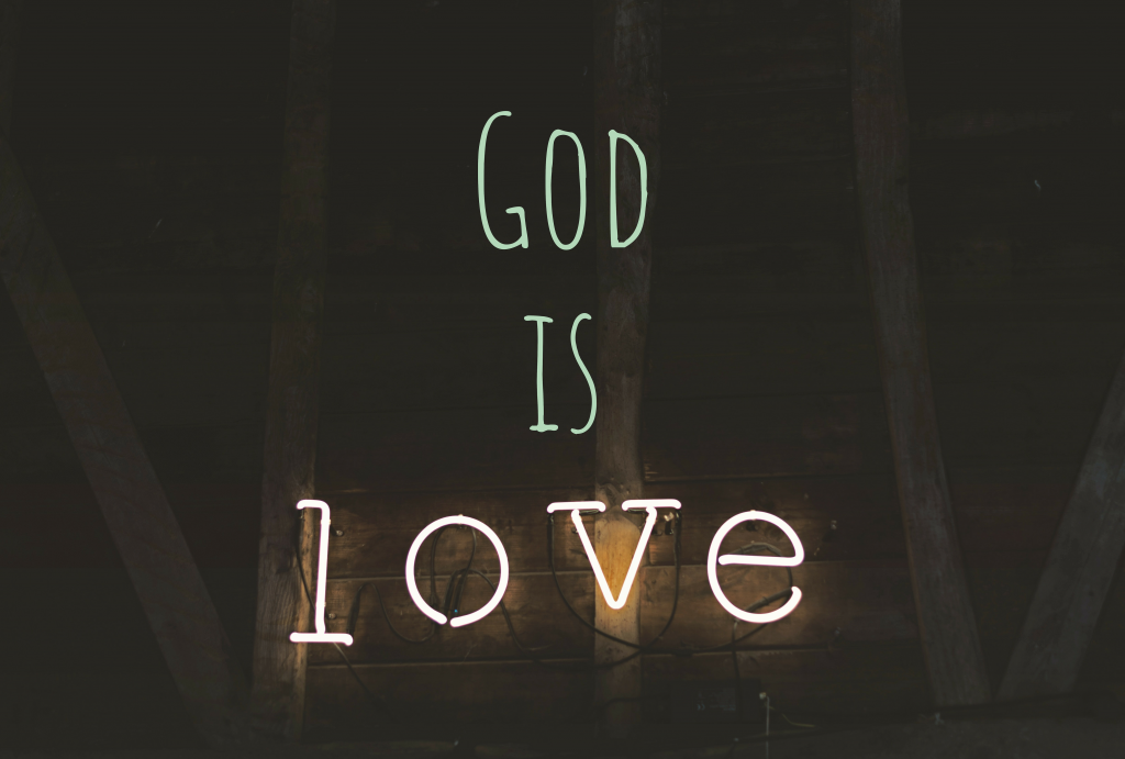 Neon sign that says 'God is love'.