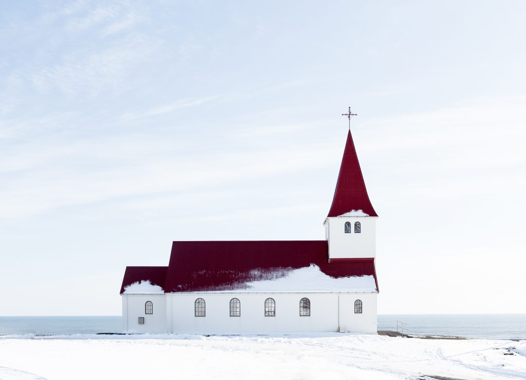 A wintery church in the snow. Church attendance at Christmas is of vital importance to all Christians.