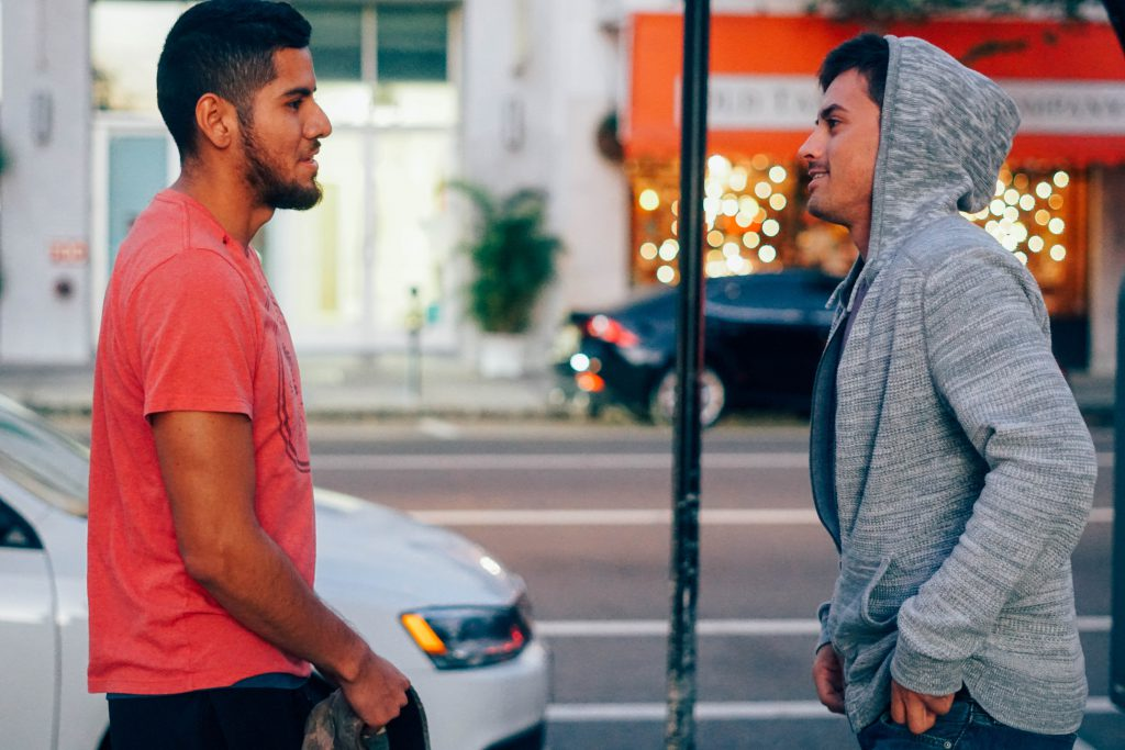 Two young men on a street talk candidly about Jesus and God's saving grace. Learning how to talk about Jesus is something we can all easily do.