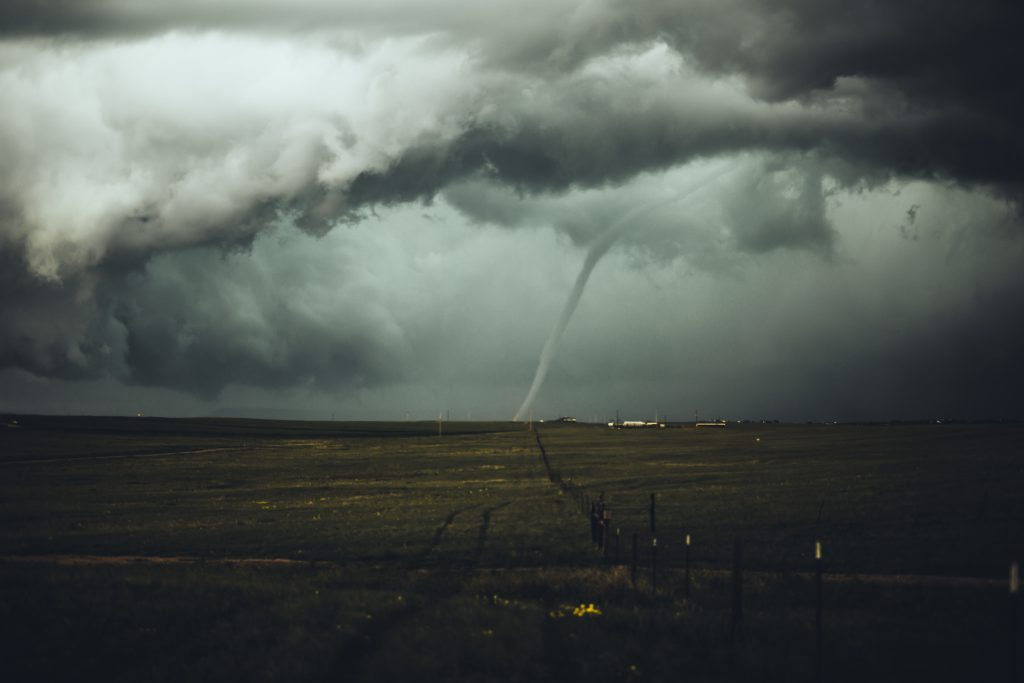 A twister hits the ground near property in the countryside. Referring to the question, why does God allow evil and suffering in the world?