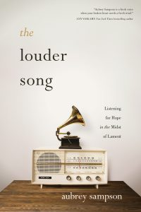 The front cover of Aubrey's book, The Louder Song, a powerful exploration of lament, and how God's healing is always the 'louder song' than our own pain.