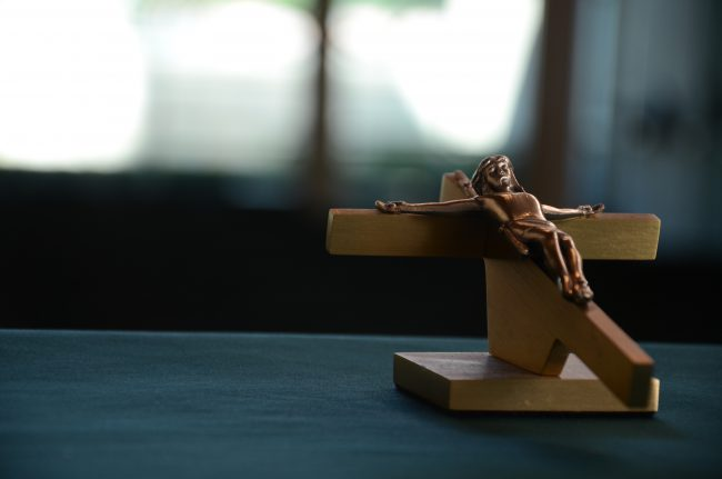An image of Jesus on the Cross as a wooden statue, depicting Lent.