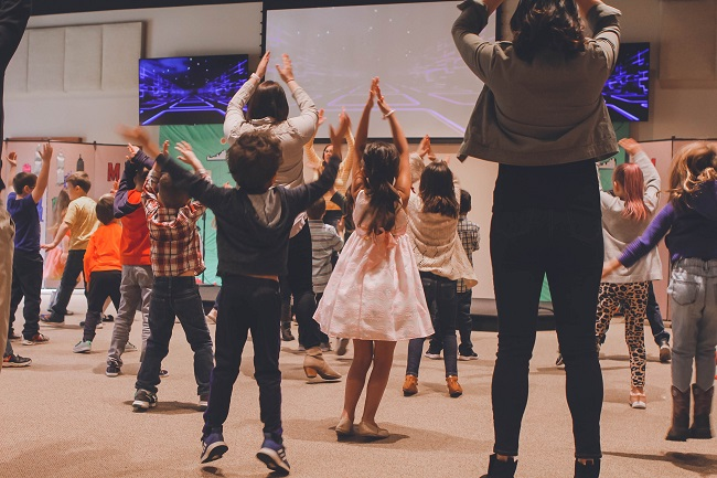 Children fill a floor doing co-ordinated dance moves in Sunday school. Could your spiritual gifts be used in your church?