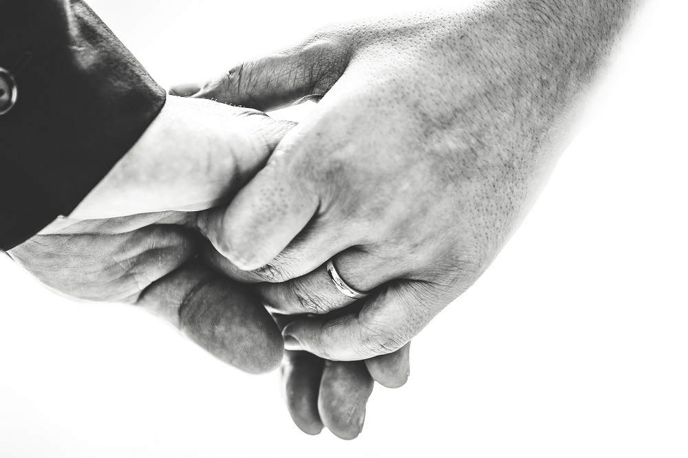 Hands are holding in close up. Do you have the spiritual gift of mercy? Or of faith?