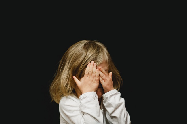 A young child hides their face behind their hands as if they have been naughty and wish to hide from God. It is too easy for humans to fall into sin because we defiantly disobey God everyday. God sees all this and chose to send His Son to help bridge the gap between us and the Lord.