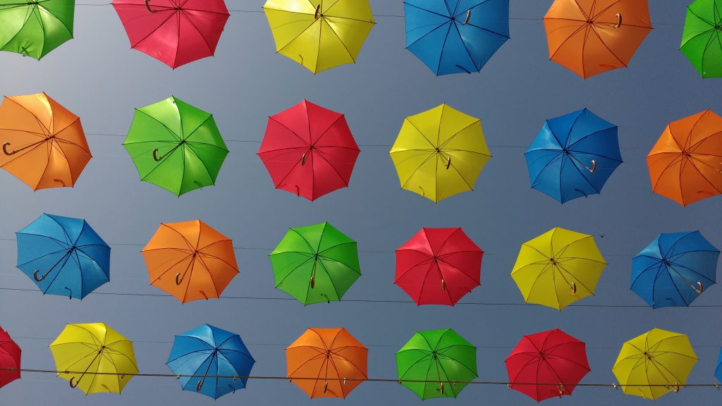Colorful umbrellas, depicting joy. Related to the Hope devotional for new believers.