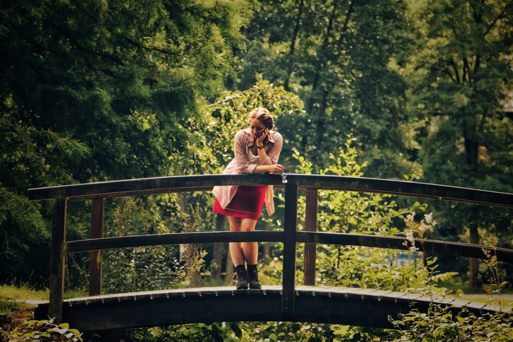 Girl on a bridge contemplating life. Share your testimony to potentially save a life!