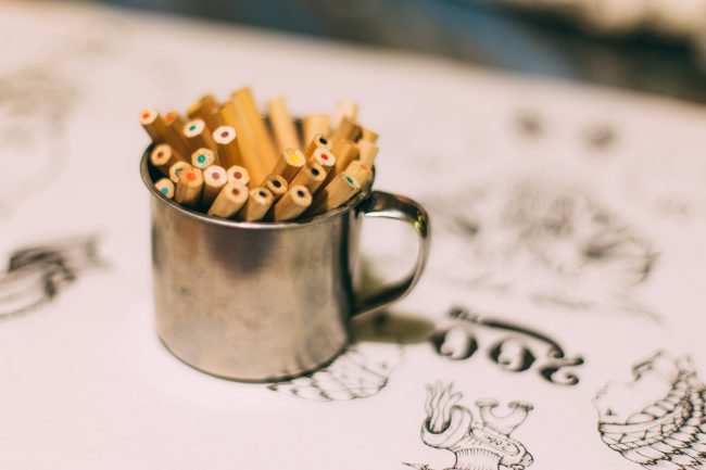 Image of colored pencils sitting in a tin mug on top of some artist drawings. Exploring the question of what is your life purpose and how do you use your gifts and skills for the Kingdom?