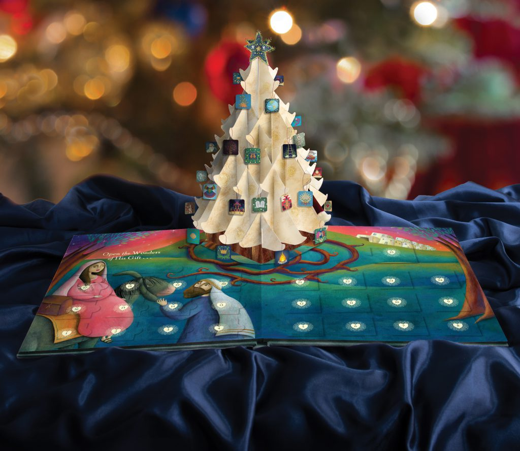An image of The Wonder of The Greatest Gift book, with a pop-up Jesse Tree and Christmas ornaments.