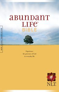 Front cover image of the Abundant Life Bible in New Living Translation. This Bible helps new believers to find the fullness of life offered in a relationship with Jesus. From this week's episode of Unfolding Stories, our new Christian testimony podcast.