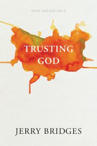 Front cover image of the book Trusting God by Jerry Bridges. We recommend this resource for anyone questioning faith - God is fully trustworthy and this books seeks to answer questions and encourage your full trust in the Lord. Listen to this week's episode of the Unfolding Faith podcast for Andrew's Christian testimony.