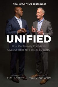 Front cover image of the book Unified, by Tim Scott and Trey Gowdy. The two men stand together, apparently engaged in conversation.